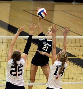 McKayla Kelly (25) and Lauren Koestler (14) defend against Katherine Ligos (21).