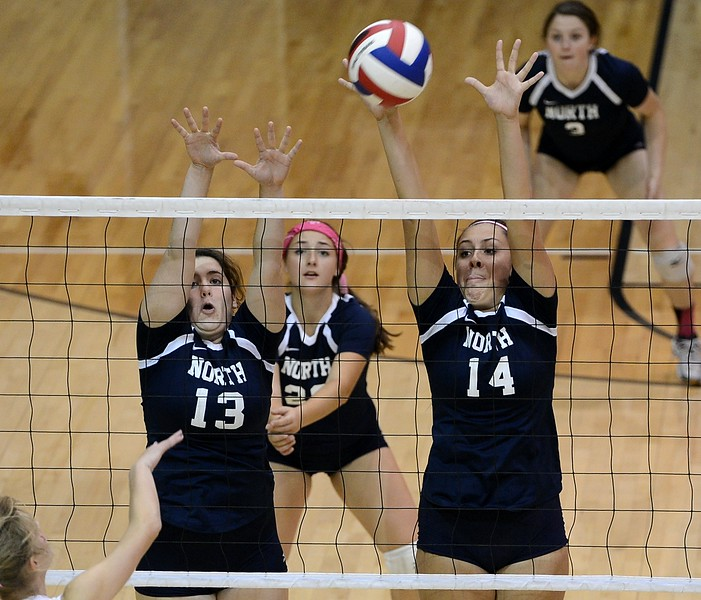 Kaelin Mealey (13) and Mackenzie Tinner (14) lead Indian defense.