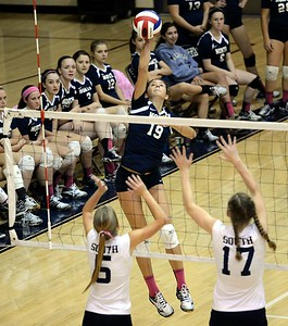 Council Rock North's Dana Bandurick (19) goes high for a kill shot.