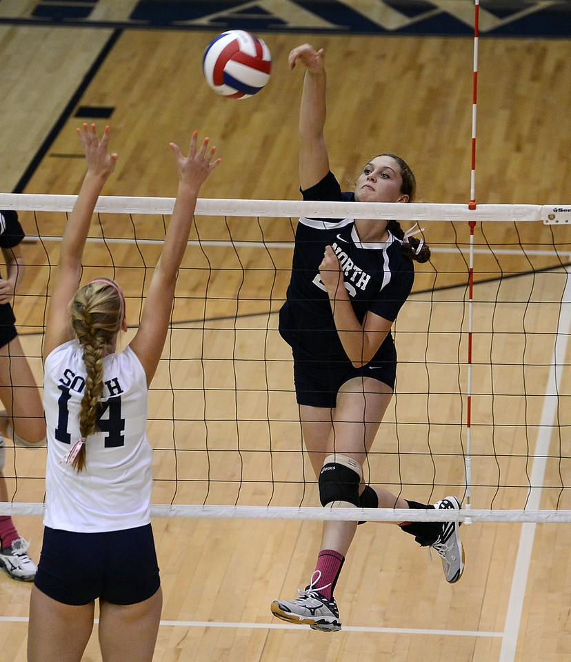 Rock North's Morgan Collito (26) goes all out for kill shot.