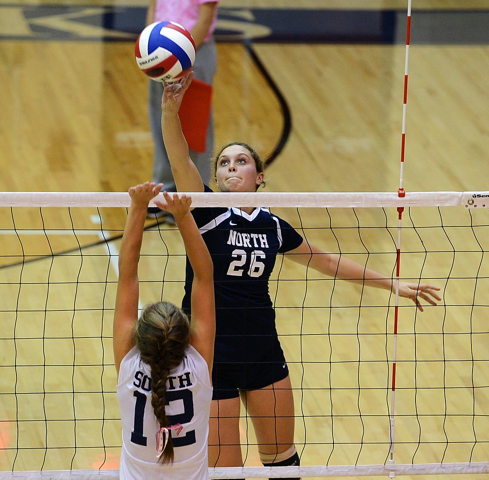 Morgan Collito (26) tries to finesse ball by CR South's Lauren Koestler (14).
