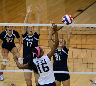 Council Rock South's Faith Turner (16) tries to get ball by North's Hadley Grundman (17) and Katherine Ligos (21).