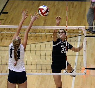 Morgan Collito 26) scores over Hannah Devlin (12).