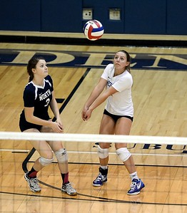 Madeline Moore (2) and Caroline Kuiken (3) eye up a dig shot.
