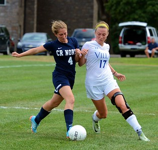 Council Rock North's Caitlin Duffy, No. 4, left, tussles for the ball with Villa Jo's Shannon Coleman (#17)  in a recent girls soccer scrimmage between the schools. (John Gleeson – 21st-Century Media)