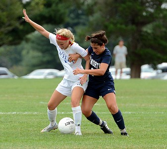 Rebecca Margolis (#2, right) and Casey Kilchrist (20) try to outmuscle each other.