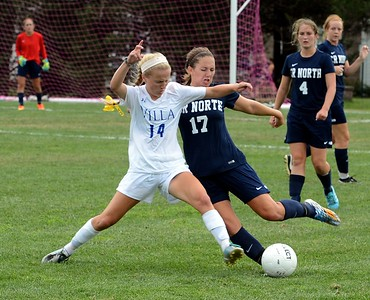 Murphy Agnew (#14) and Caroline Erlandsen (17) collide going for the ball.