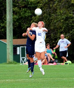 Casey Kilchrist (20) and Carly Blair (14) go for a header.