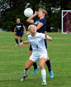 Murphy Agnew (#14) vies with Caitlin Duffy (4) for header.