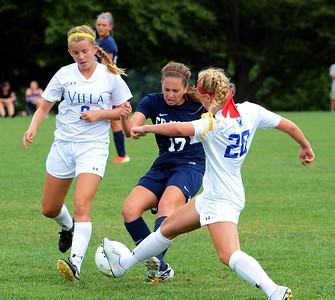 Caroline Erlandsen (#17) clears ball by Megan O'Neill (9) and Casey Kilchrist (20).