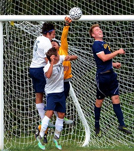 Eric Levine (#15) and Conor O'Donnell (11) try to get ball by Wissahickon goalkeeper Jun Yuh.