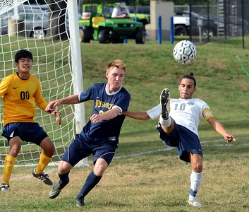 Nick Guarna, #10, right, tries to flip ball toward the goal for the Indians.