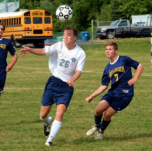 Carter Steckbeck (#26) heads ball upfield for CR North.