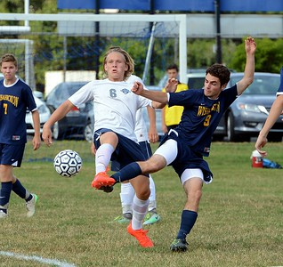 Nikita Ihlin (#6) and Jacob Kaffey (9) perform soccer ballet.