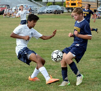 Akash Shah (#29) clears ball by Dave Goldstein (7).