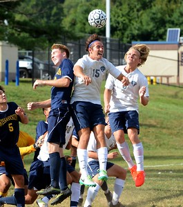 Eric Levine (#15) and Nikita Lhlin (6) battle Pat McCarry (23) in front of Wissahickon goal.