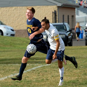 Nick Guarna, #10, right, and Pat McCary (23) battle for possession.