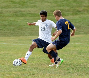 Akash Shah, #29, left, beats Dave Goldstein (7) to the ball in Sept. 2 home and season-opening battle with Wissahickon won by the Indians. (John Gleeson – 21st-Century Media)