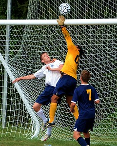 Wissahickon goalie Jun Yuh knocks ball away from Seamus Crosett (4).
