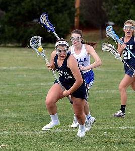 Lauren D'Amelia (23) looks for an open teammate.