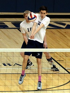 CR South sophomore South's Dane Paulson (#15) performs dig shot.