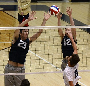 CR North senior Jason Yakimiv (#23) and Harry Wyatt (12) play tough at the net.
