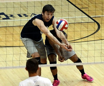 Council Rock North senior Jason Yakimov digs low to return volley in Indians 3-0 match win over sister school South May 3 on the Golden Hawks' home court. (photos by John Gleeson)