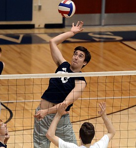 CR North senior Jason Yakimiv (#23) lines up a kill shot.