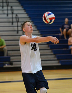 Nick Baniewicz (14) eyes up a dig shot.