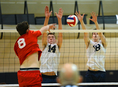 Nick Baniewicz (14) and Jack Gunshenan (25) play tough at the net