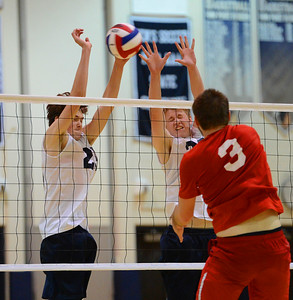 Jack Gunshenan (25) and Will Hewitt (32) make key block in decisive set.