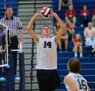 Nick Baniewicz (14) sets ball for Kevin D'Arcy (16).
