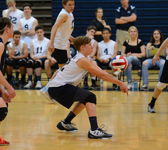 Harry Wyatt (12) digs the ball out for the Indians.