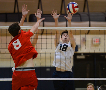 Sean Helmlinger (18) blocks shot at the net.