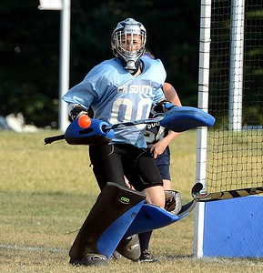 South goalie Sabrina Masone (#00) follows flight of a shot on goal.