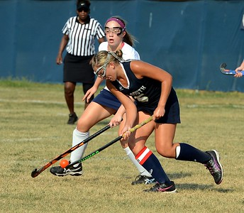 Council Rock South's Caroline McGovern (#5) scoops up a ground ball.