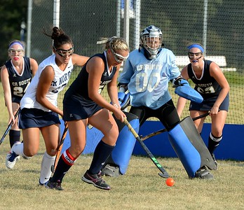Caroline McGovern (#5) clears ball from in front of CR South goal.