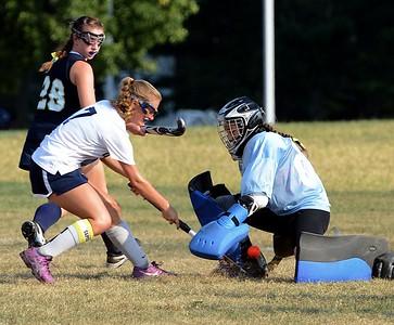 Sabrina Masone (#00) blocks Anna Lehman's (7) shot on goal.