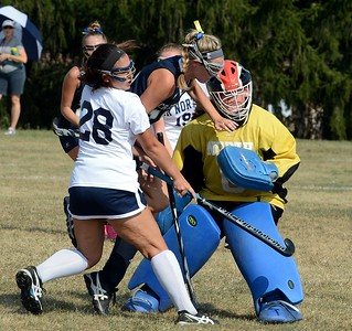 South's Paige Schmid (12) collides with gaolie Margaret D'Auria (#0) and Olivia Musto (28).