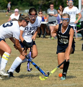 Katelyn Cocco (#35) battles Claire Jarema (13) and Sarah Everett (34) for possession.
