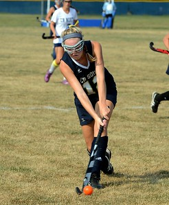 Paige Schmid (#12) advances the ball upfield for CR South.