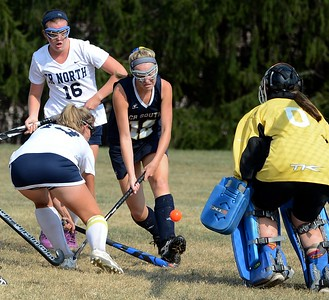 Paige Schmid (#12) pressures North goalie Margaret D'Auria.