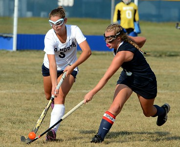 CR North senior Julianne Mangano (#5) and Sarah Womer (6) race to the ball.