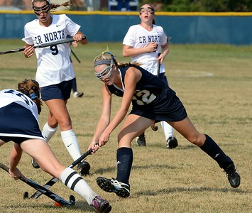 Paige Schmid (#12) goes all out to win ground ball.