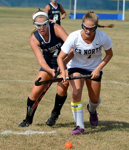 South's Marie Hammer (#7) and Anna Lehman (7) race for the ball.
