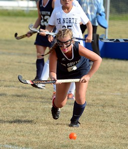 Sarah Womer (#6) lines up a shot.