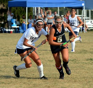 Caroline McGovern (#5) and Hannah Sullivan (9) concentrate on ball.