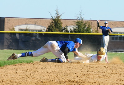 CB South shortstop Kyle Rossi, left, applies the tag in time to pick Council Rock South senior Shaun Stackhouse off second base.
