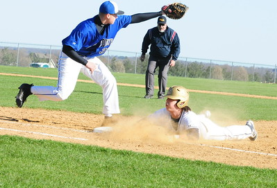 CB South first baseman Tom Dugan, left, gets the throw too late to pick off Council Rock South baserunner Kyle Fleming in 7-4 Hawks win over the Titans March 29, 2016. (photo by Steve Sherman)