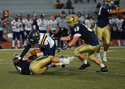 Sam Vaniver (38) and T.J. Pritz (58) combine to sack Jordan Gyabaah (1)